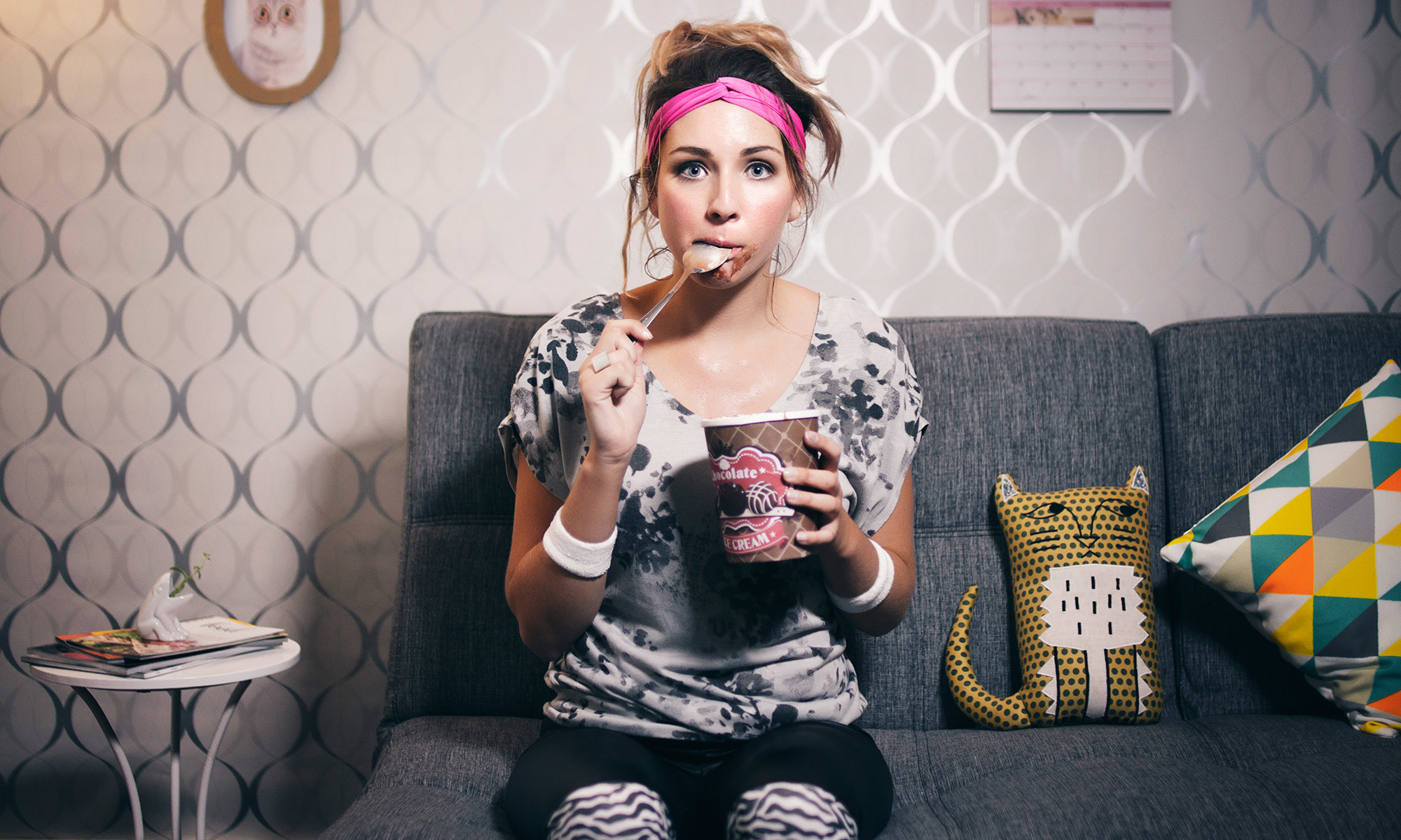 Girl on couch eating ice cream
